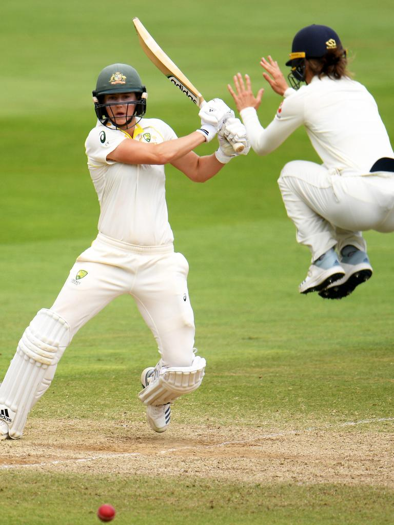 Ellyse Perry of Australia plays a shot as Amy Jones of England takes evasive action. Picture: Harry Trump/Getty Images