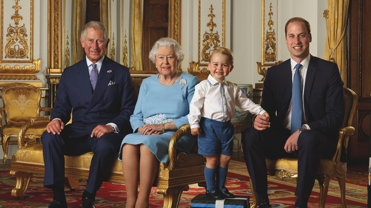 Prince George with Prince Charles, Queen Elizabeth, and Prince William. Picture: Royal Mail/PA