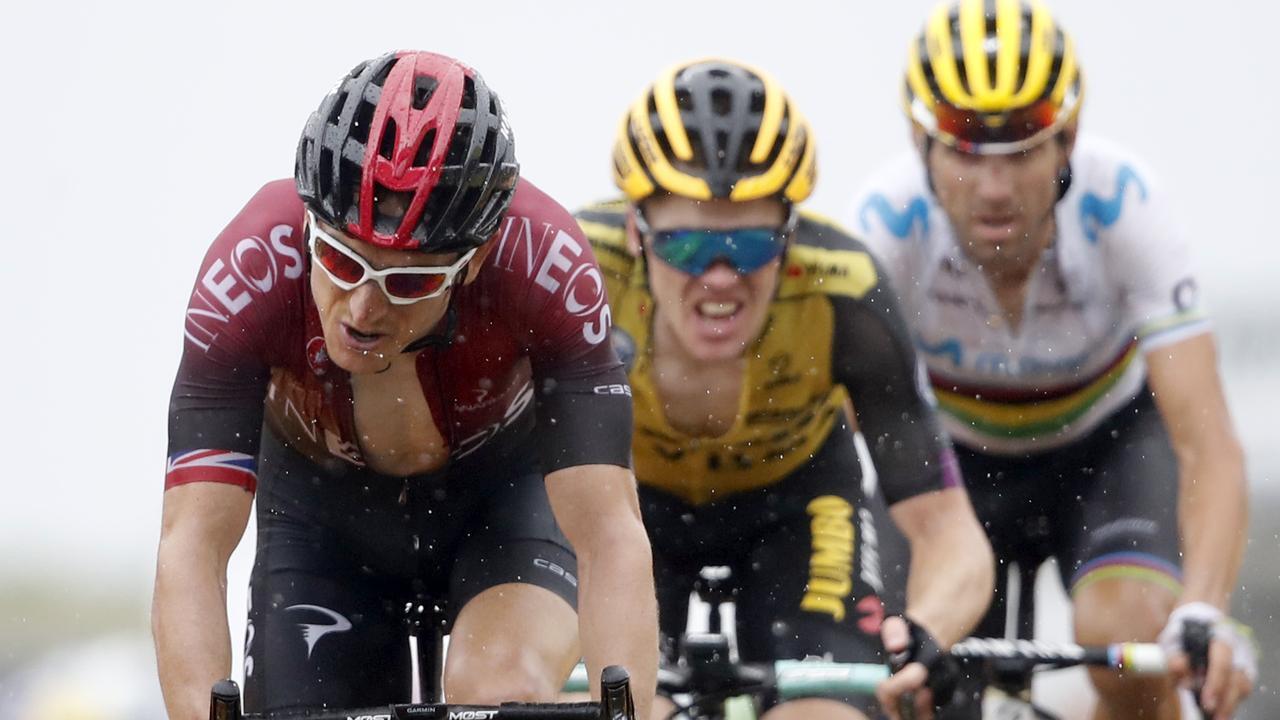 Britain's Geraint Thomas, left, Netherlands' Steven Kruijswijk, centre, and Spain's Alejandro Valverde cross the finish line. Picture: AP Photo/Christophe Ena