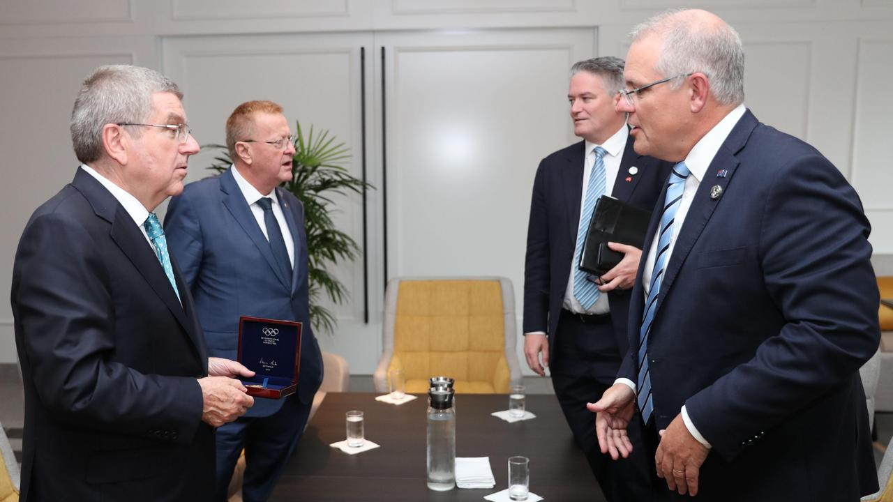 Olympics chiefs Thomas Bach and John Coates with Prime Minister Scott Morrison and Finance Minister Mathias Cormann at the G20 Summit earlier this month.