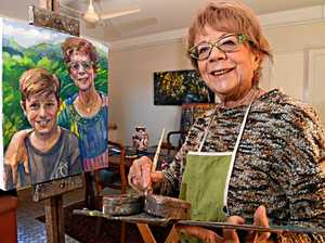 Artist transforms blank canvas of life with paint brush