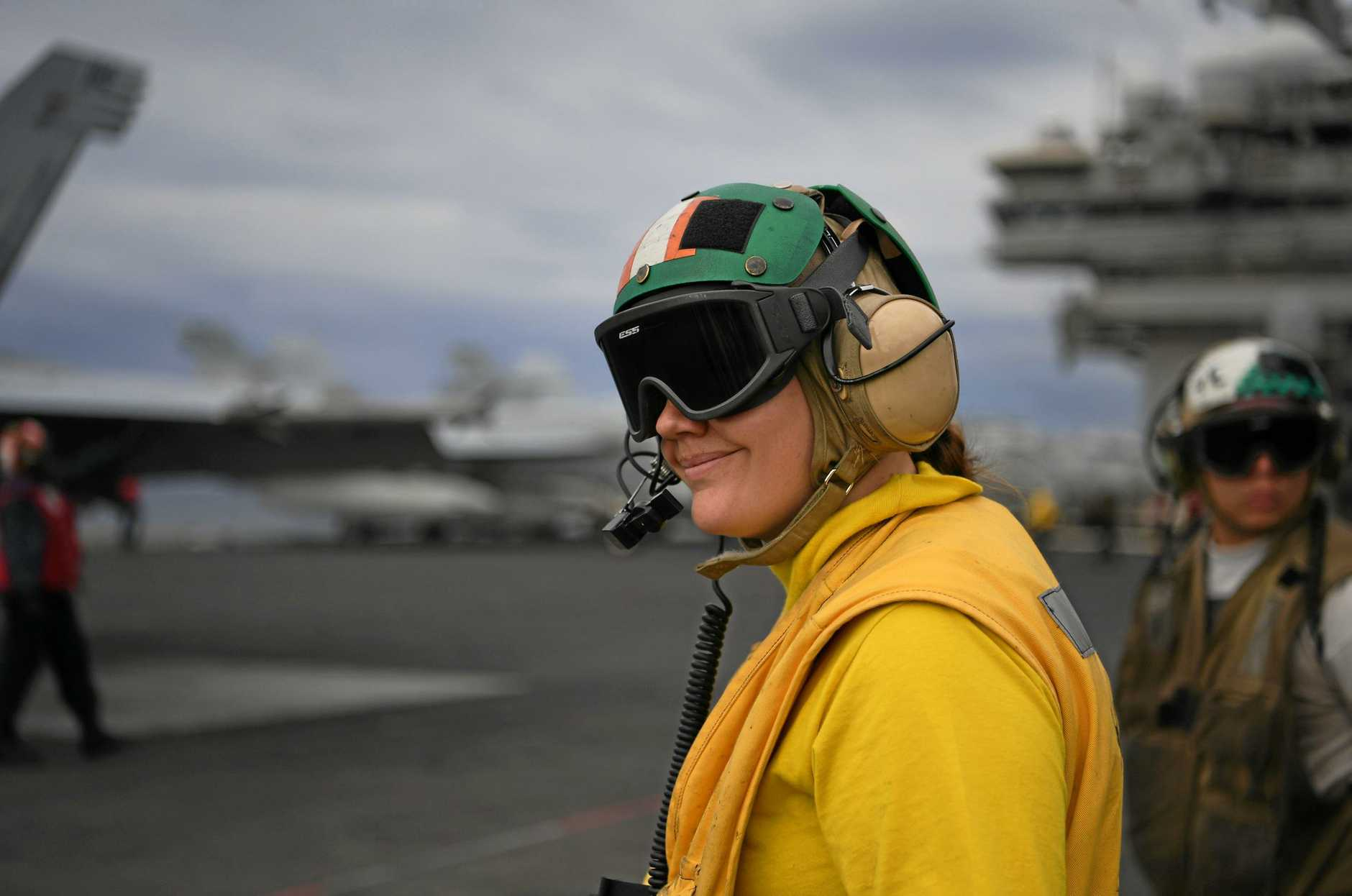 A USS Ronald Reagan crew member on the flight deck.