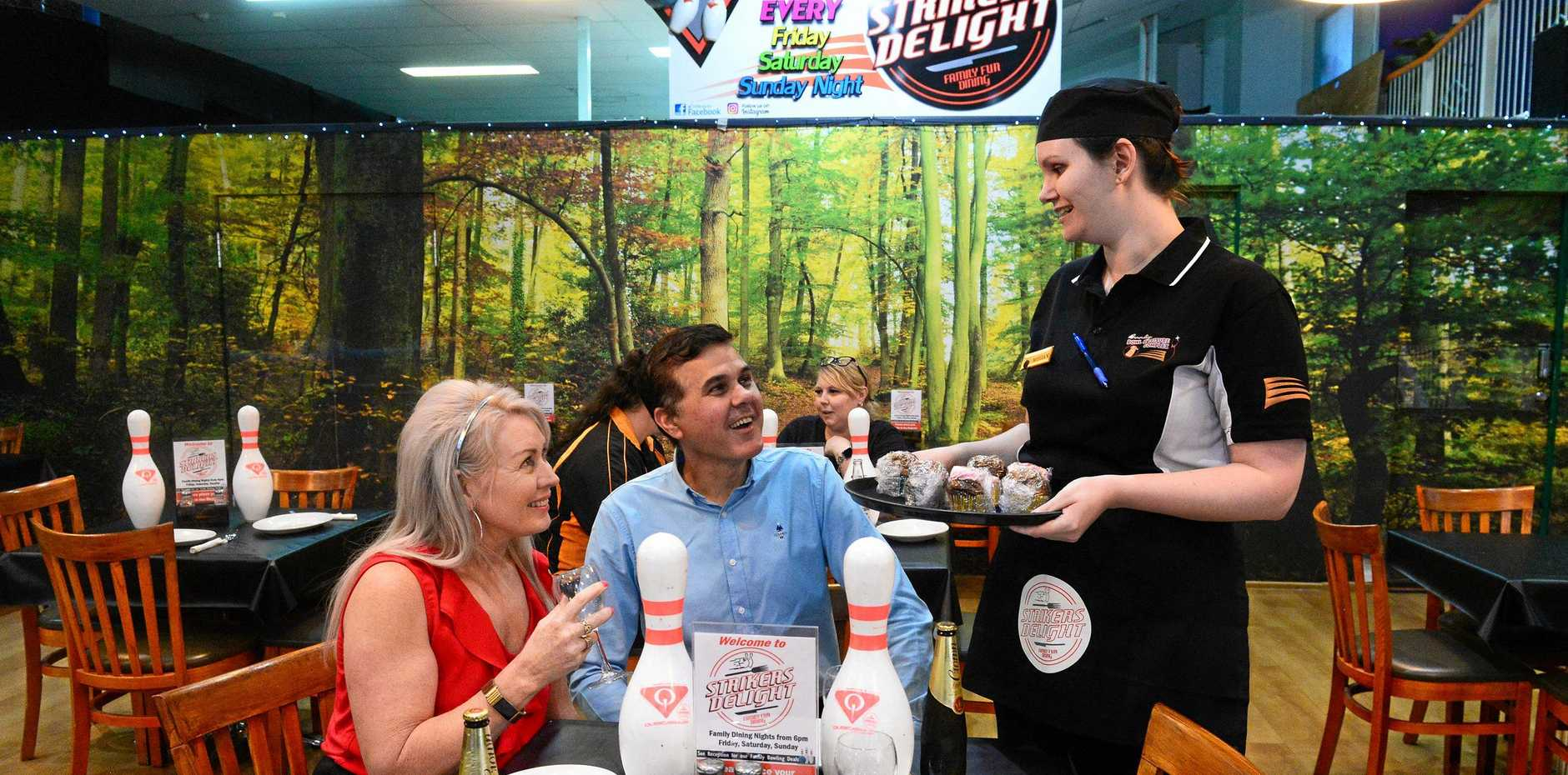 STRIKERS DELIGHT: Jeanette and Peter McElligott with Megan Woodgate at Bundy Bowl and Leisure.