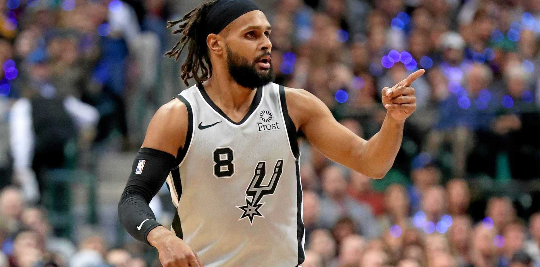 Patty Mills of the San Antonio Spurs reacts after scoring against the Dallas Mavericks in the second half at American Airlines Center on January 16, 2019 in Dallas, Texas.