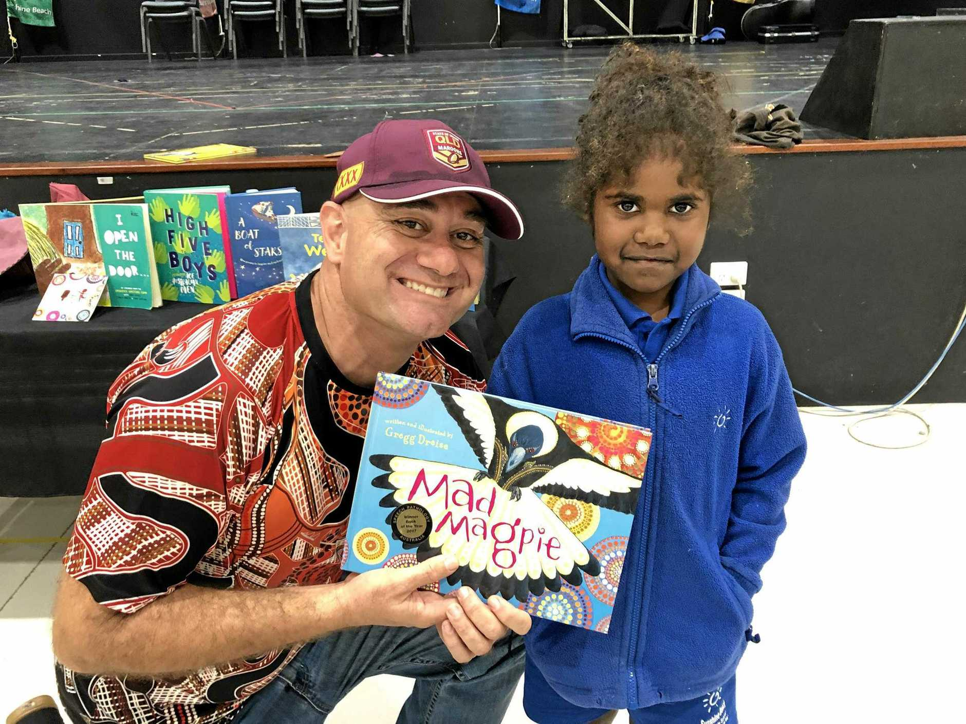 AUTHOR'S VISIT: Gregg Dreise enthrals Year 1 student Jahleice, from Sunshine Beach State School, with his storytelling.