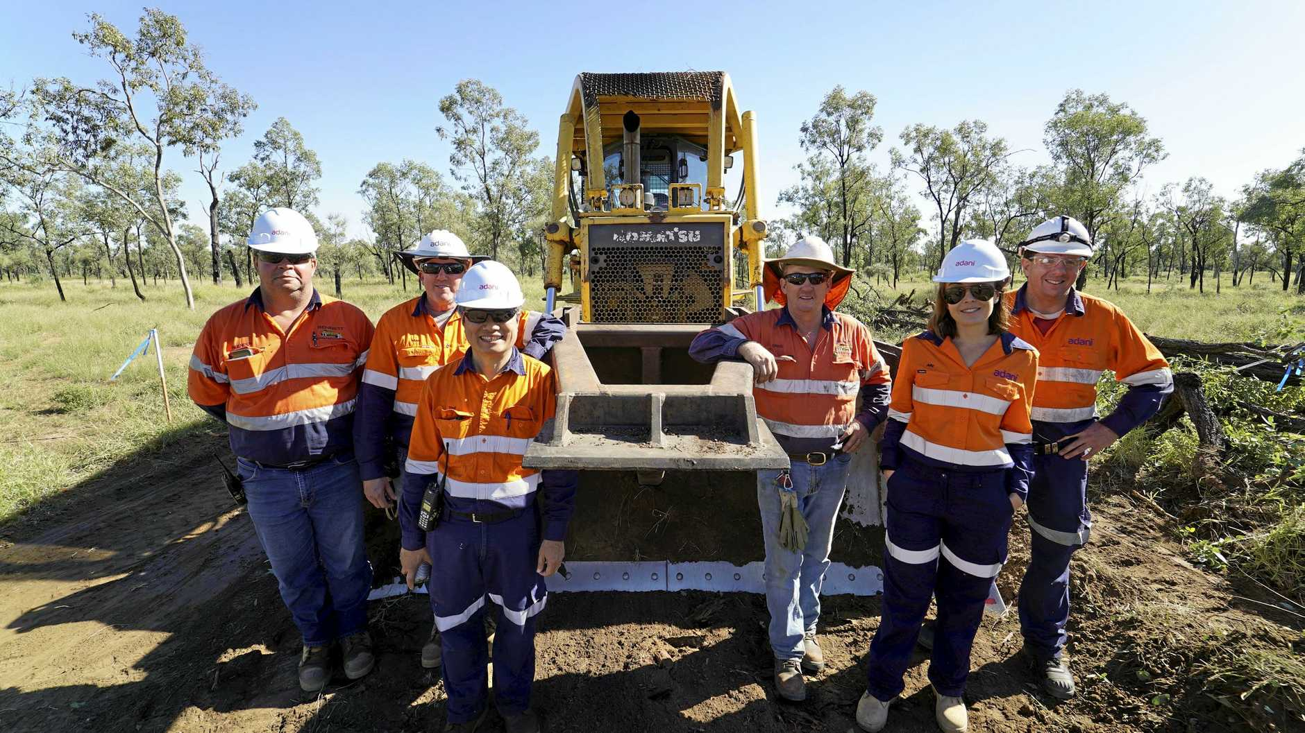 MINING JOBS: Brenden Dousling (far left) and Greg Bennett (third from right) from Clermont and Adani staff commencing construction at the Carmichael Mine.
