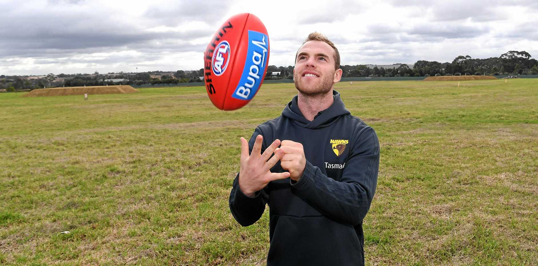 Reigning Brownlow medalist Tom Mitchell will play with Hawthorn until at least the end of the 2023 season. Picture: Julian Smith/AAP