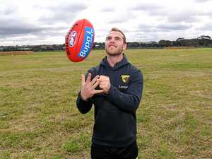 Hawks extend contract of Brownlow Medal winner Tom Mitchell