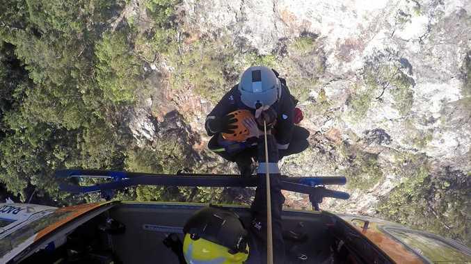 Woman rescued off Mount Larcom cliff edge