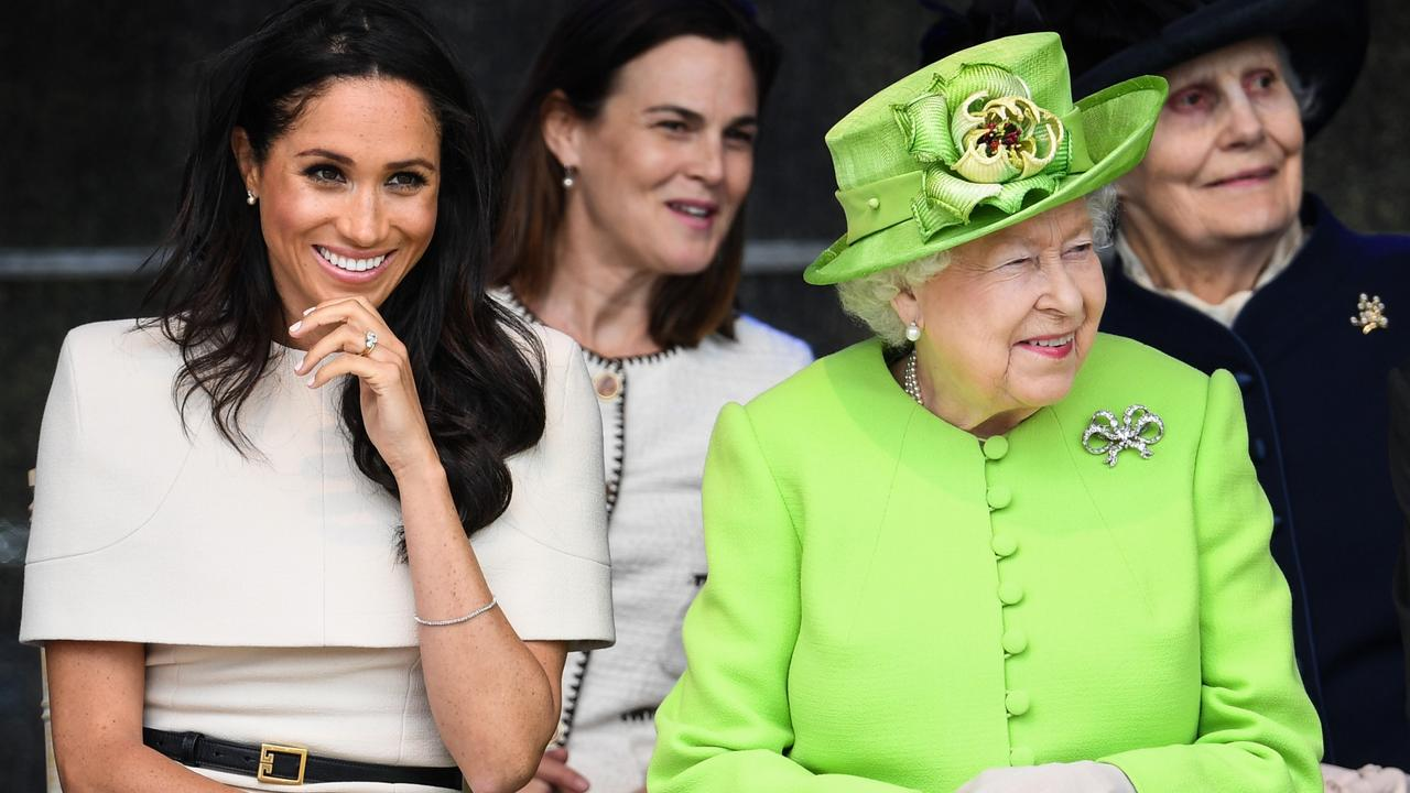 Talking fashion? Royal style star the Duchess of Sussex with Queen Elizabeth. Picture: Getty Images