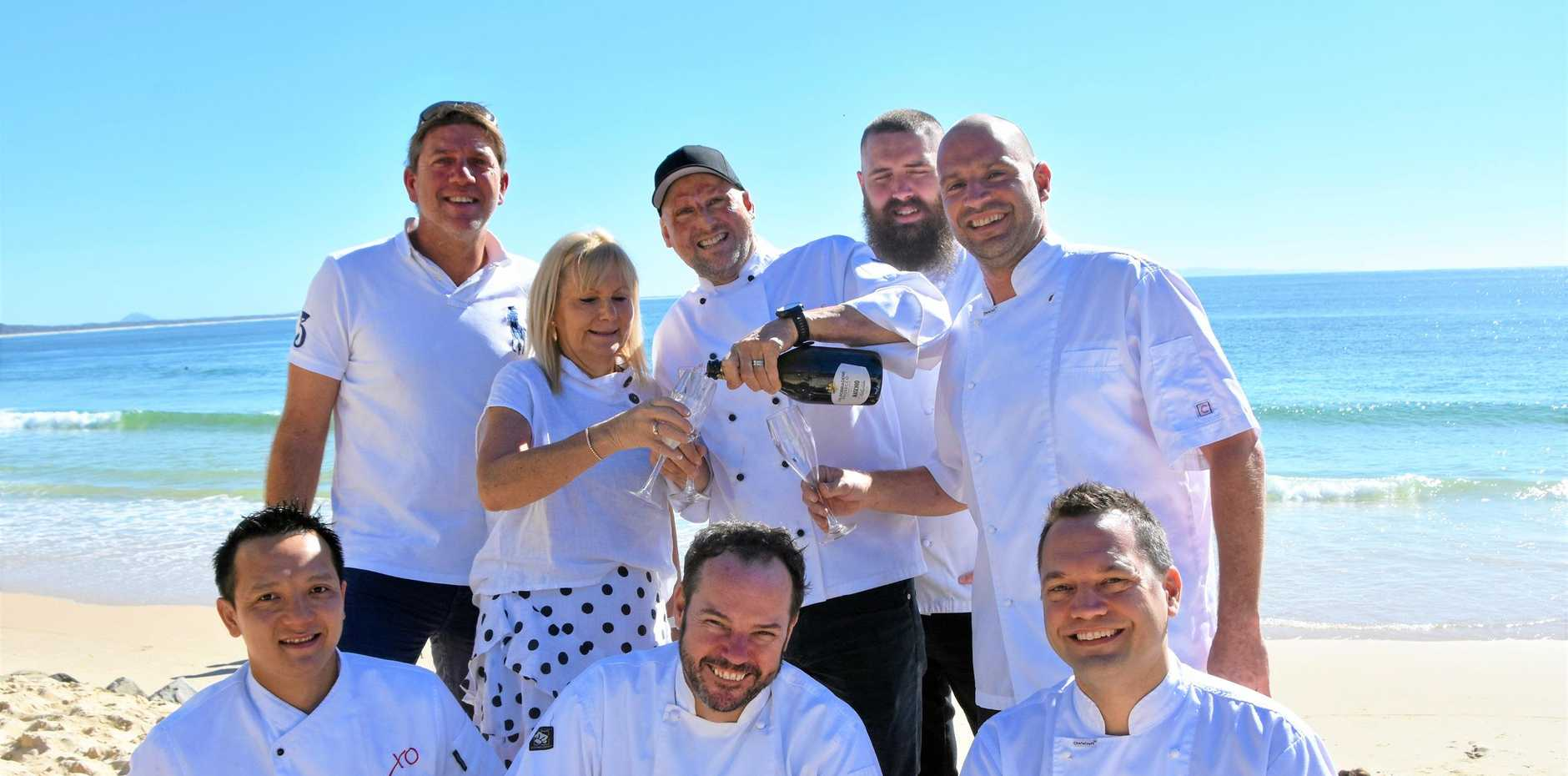 DINE IN WHITE: (Front left) Jame Wu, Shane Bailey, Ollie Carruthers, (back left) Phil Bradford, Susie O'Neil, Matt Golinski, Andrew Wilcox and Mitch Kmiecik .