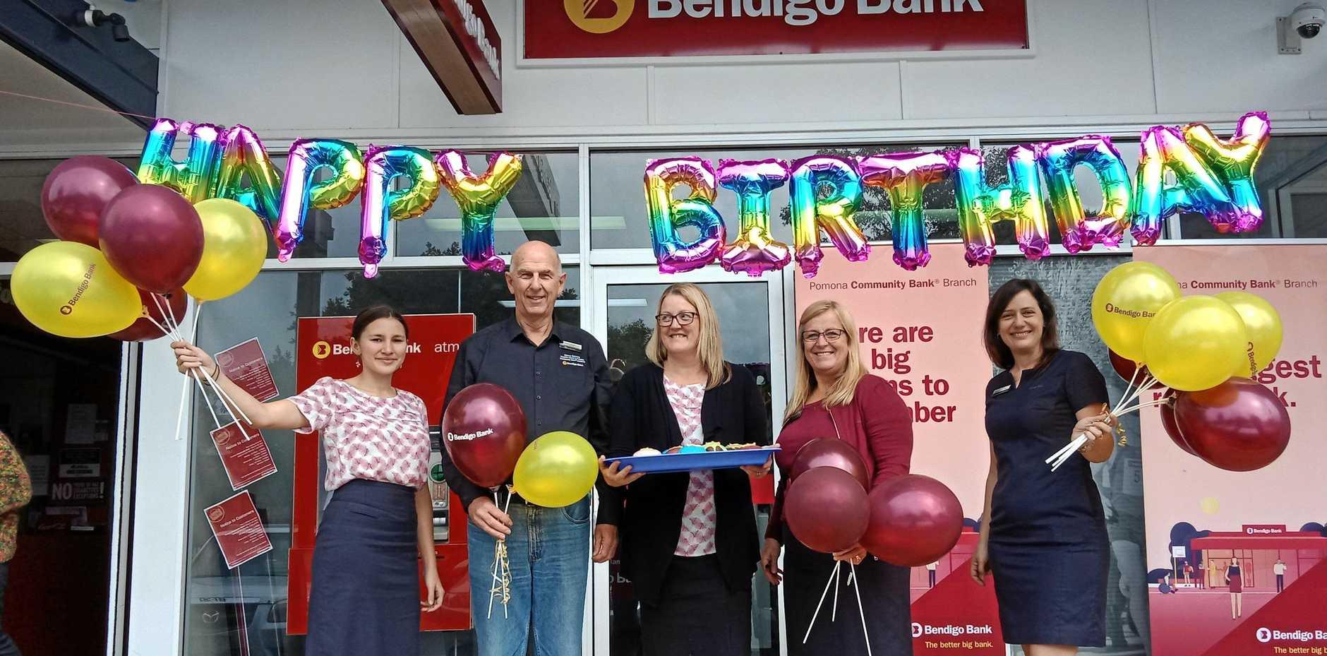 HAPPY BIRTHDAY: Ella Dawes, SCCFSL chairman Rick Cooper, Simone Flavelle, Jo Winter and Amanda Schilds celebrate Pomona Community Bank branch's second birthday.