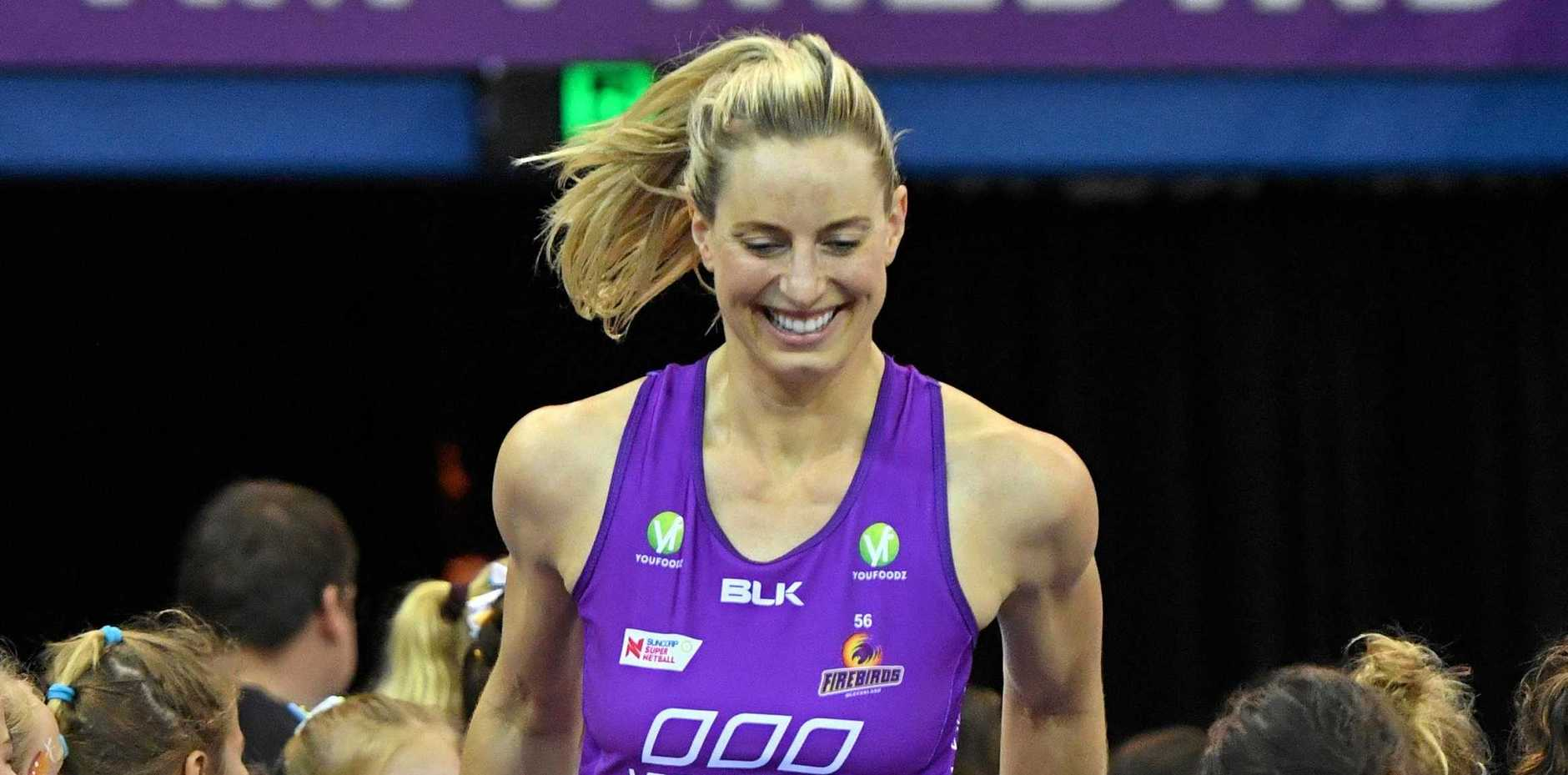 Laura Geitz of the Firebirds is seen running onto the court at the start of the Round 14 Super Netball match between the Queensland Firebirds and the Magpies.