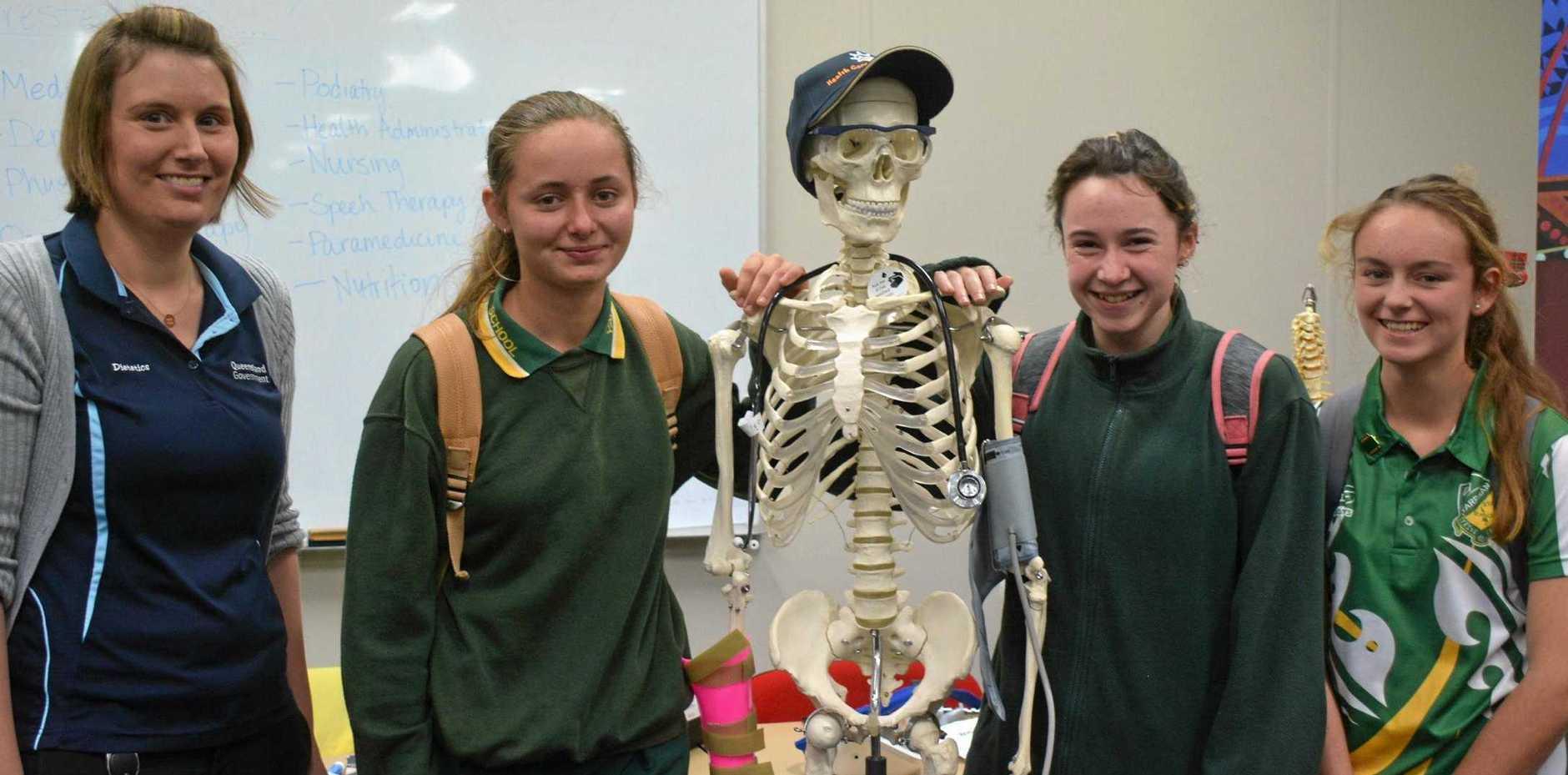 NEW FRIENDS: Dietitian Trina Laidlaw from Kingaroy Hospital and Bridget Dando, Jhavana Perren and Thai-Lia Currell from Yarraman High School meet a new friend 'Sid' the skeleton at last year's careers expo at Kingaroy TAFE.
