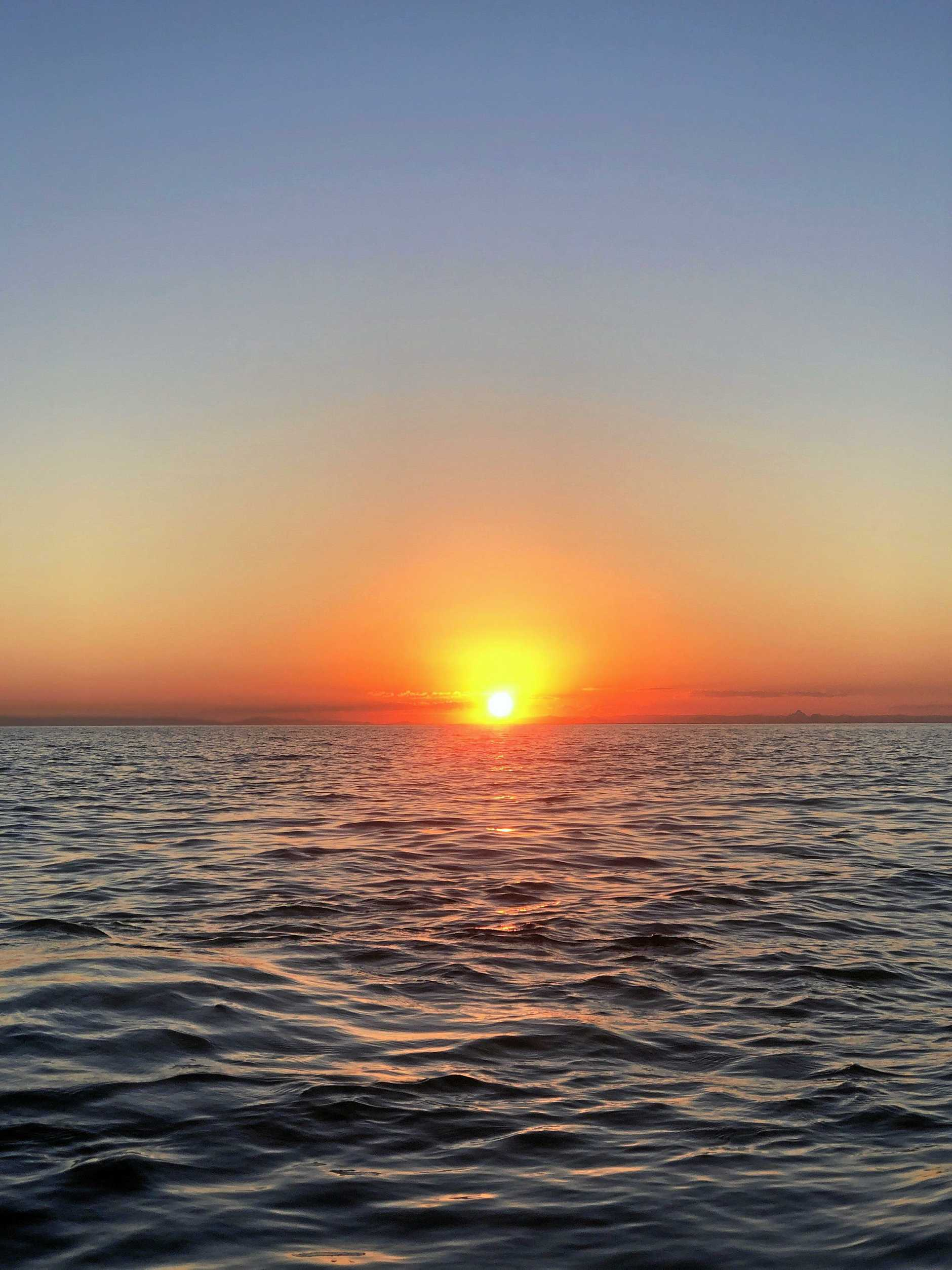 Experience the perfect Moreton Island sunset on an illuminated kayak tour at the wrecks. It's an experience you won't forget.