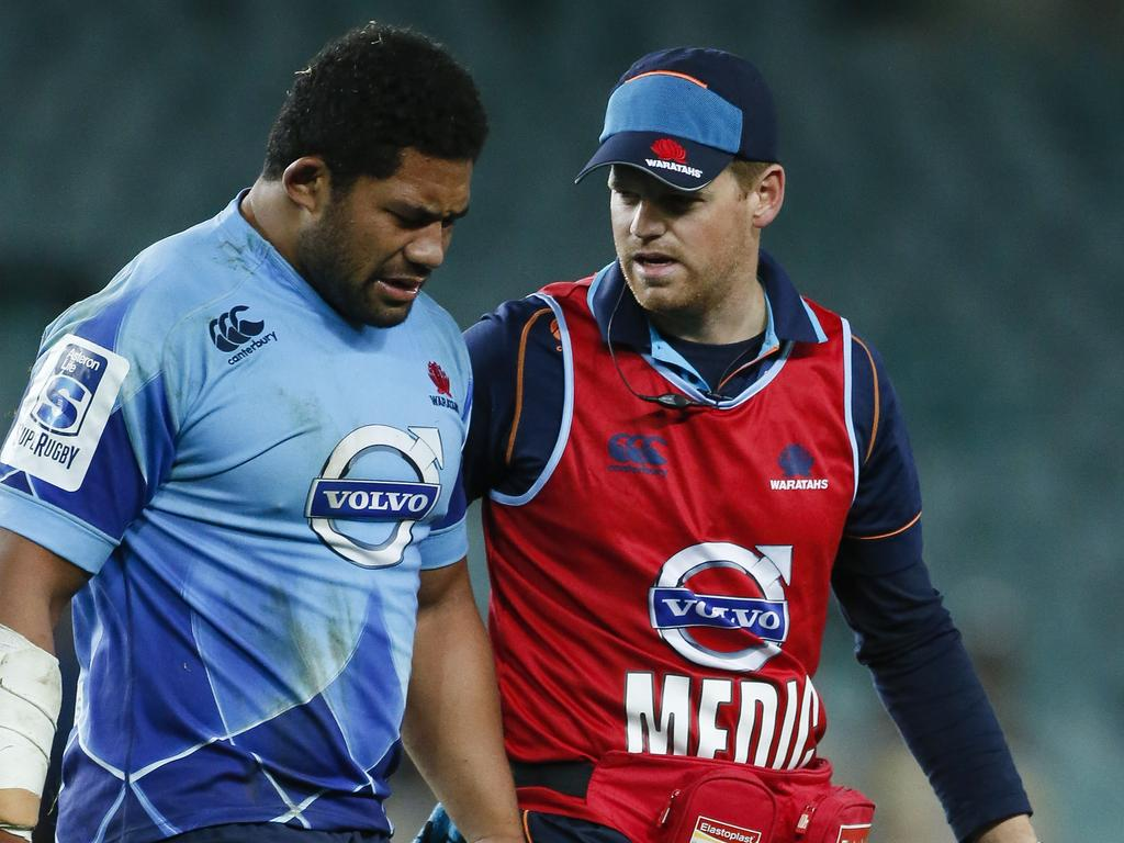 Tatafu Polota-Nau is helped from the field while playing for the Waratahs. The hooker has suffered seven major concussions.Picture: Mitch Cameron
