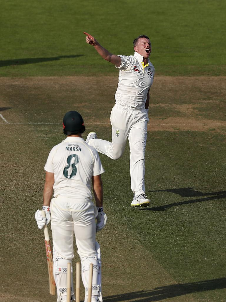 Peter Siddle, who claimed 3-20, celebrates after taking the wicket of Mitch Marsh. Picture: Ryan Pierse/Getty Images