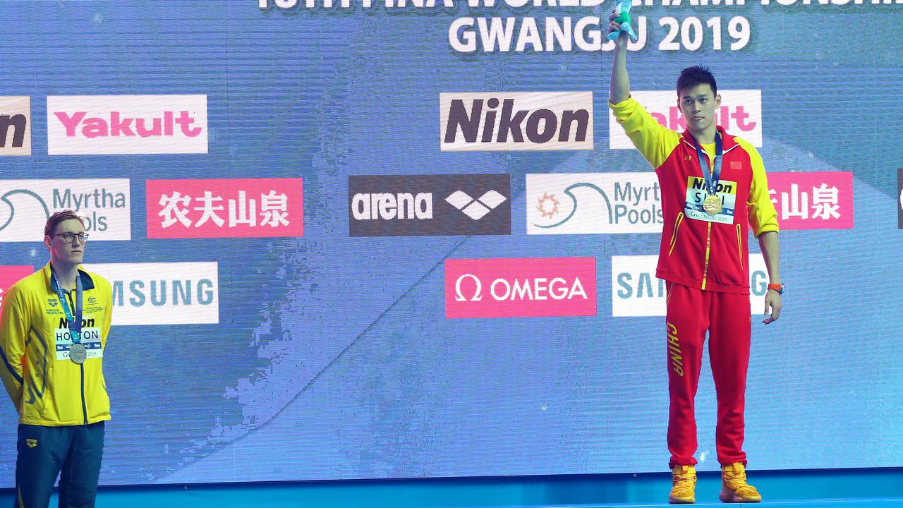Silver medallist Mack Horton of Australia refuses to share the podium with gold medallist Sun Yang of China during the medal ceremony for Men's 400m Freestyle Final at the FINA World Championships. Picture: Maddie Meyer/Getty Images