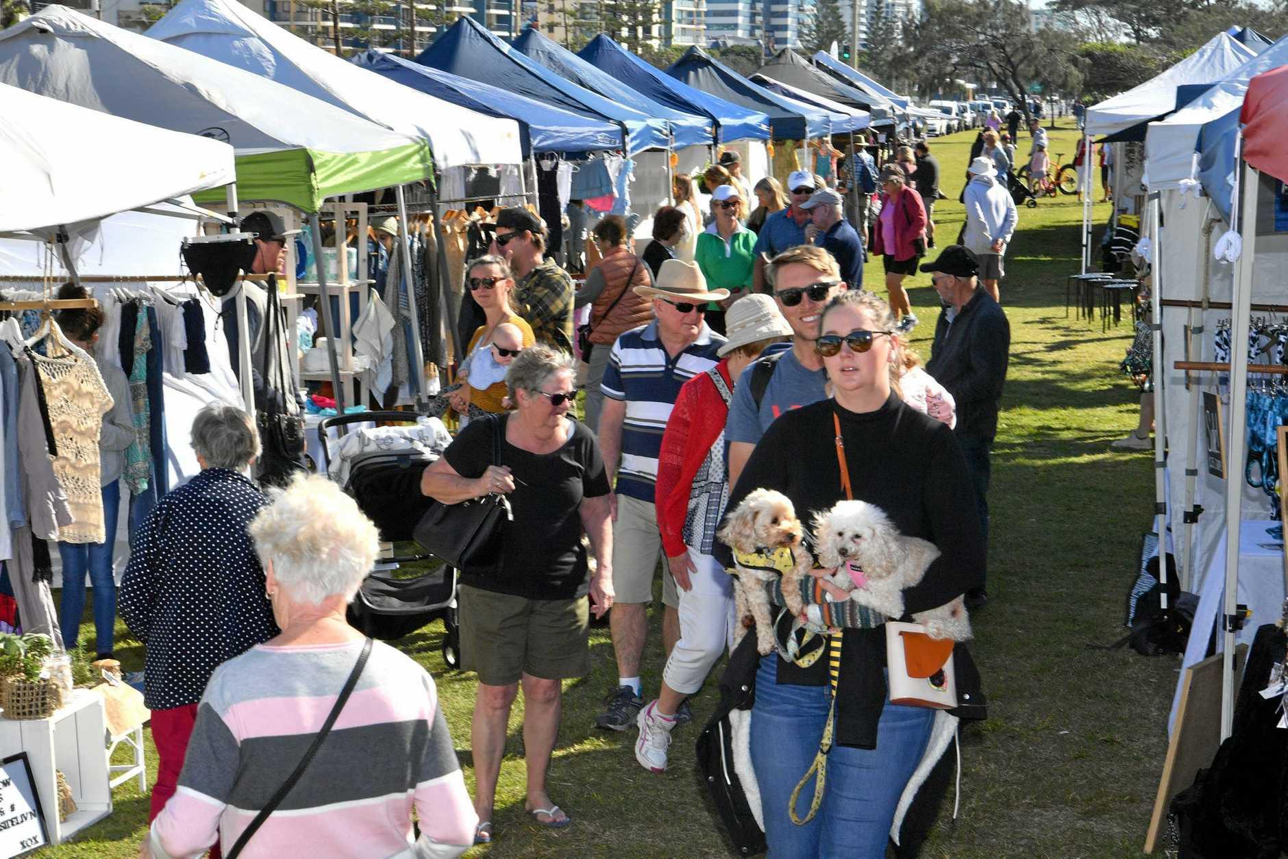 People enjoying the Sunshine Coast Collective Markets at Alexandra Headland.