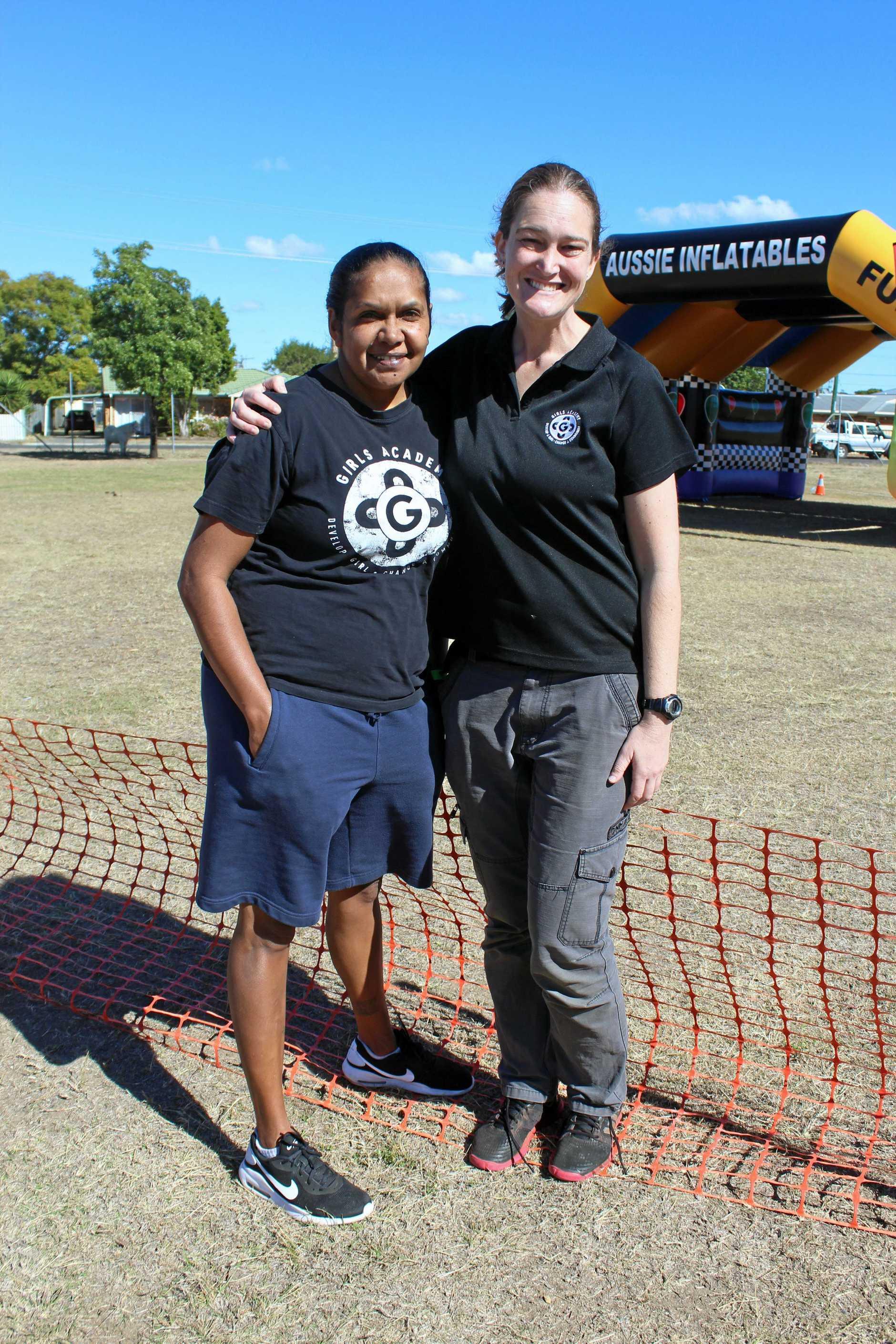 Barrambah Girls Academy development officer Audrey Conlon and program manager Leena Lehtonen enjoy the Murgon Rail Trail Festival.