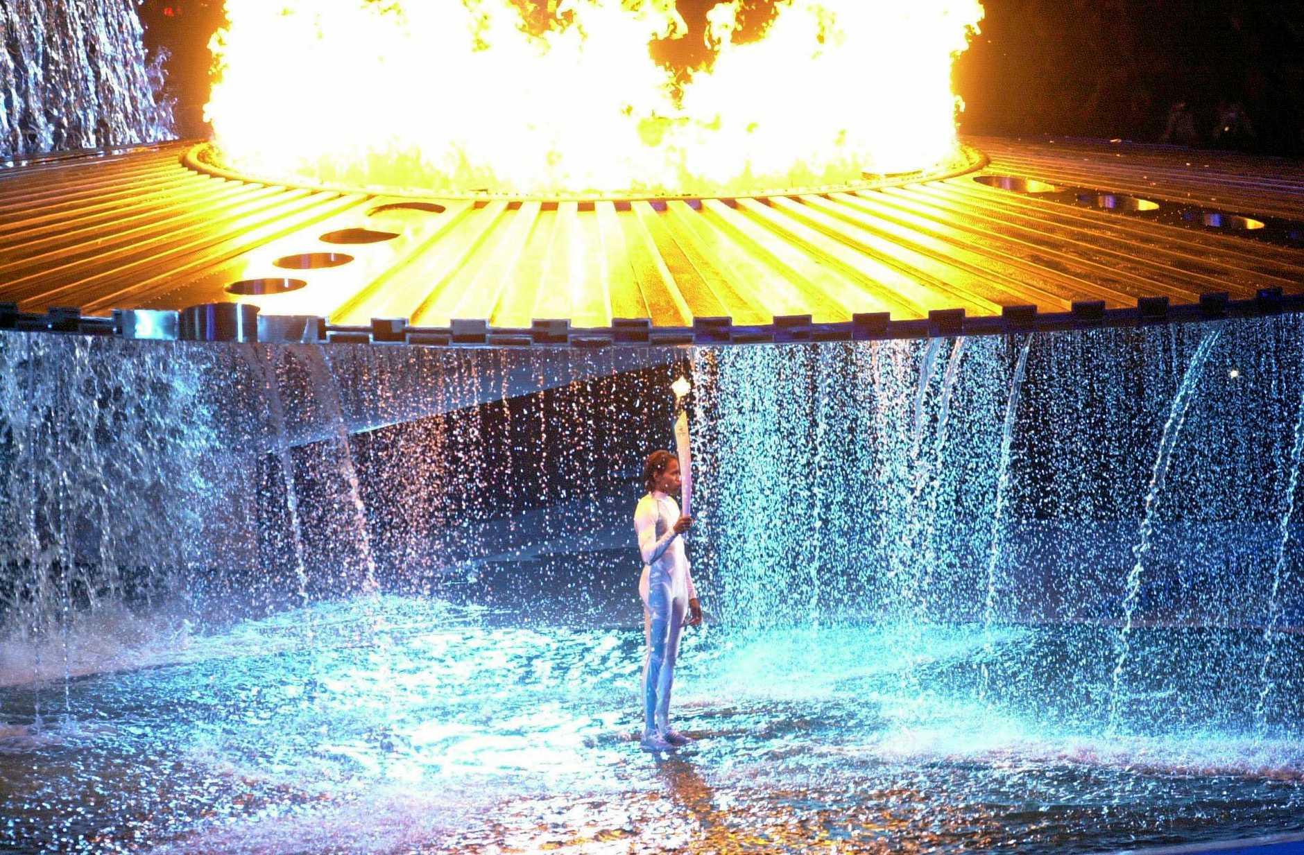 A Sept. 15, 2000 file photo of Australian 400m queen Cathy Freeman standing beneath the Olympic flame after lighting it up at the 2000 Olympic Games Opening Ceremony in Sydney.