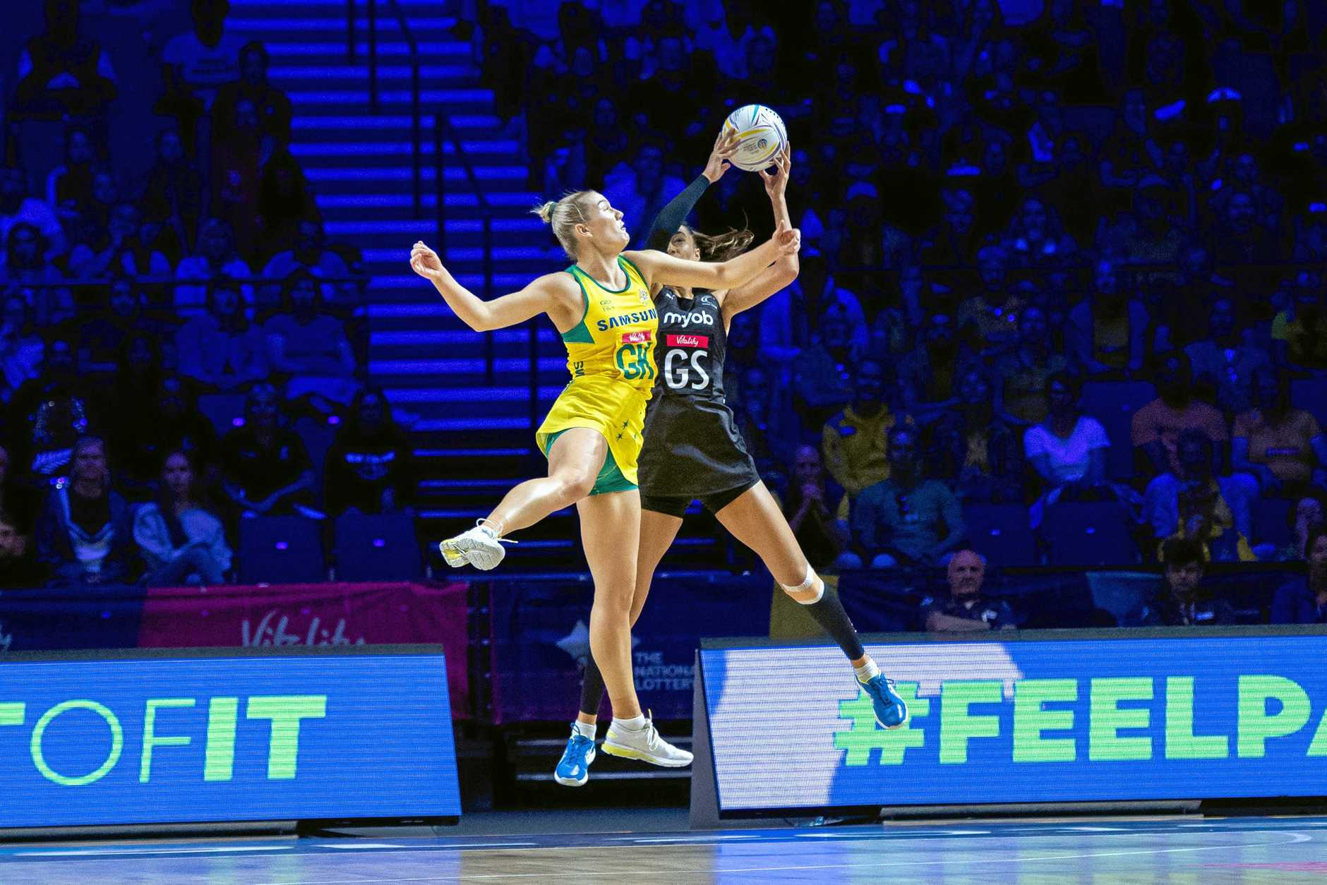 CUP: Courtney Bruce (L) of Australia and Bailey Mes (R) of New Zealand jump for the ball during the World Cup.