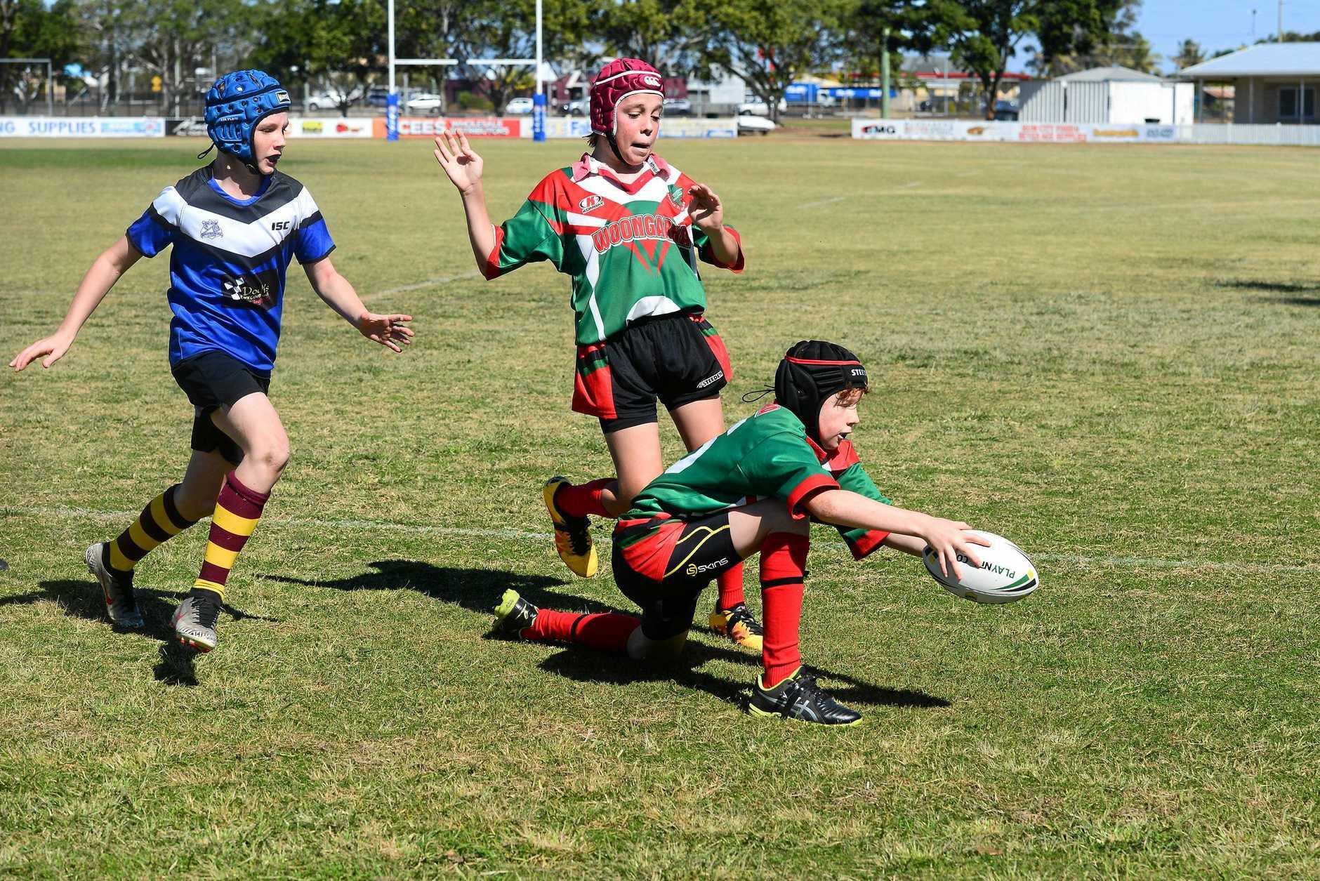 MATCH WINNER: Woongarra State School's Hudson Strickfuss scores the try that won the match.