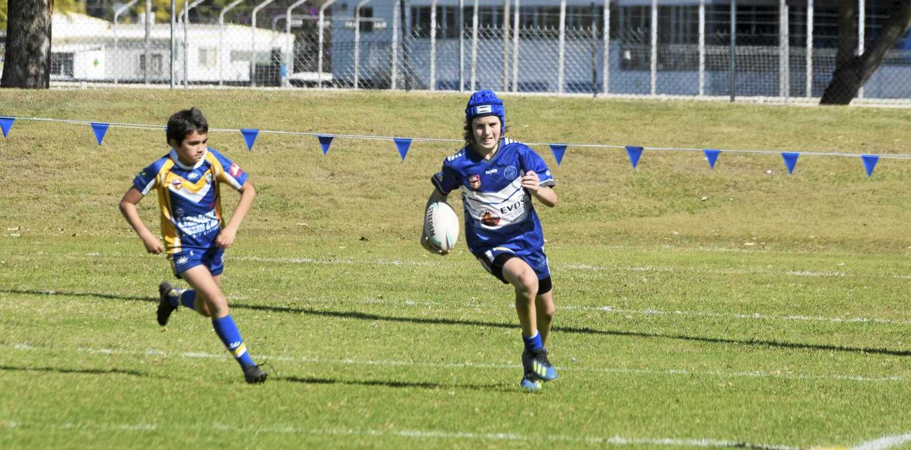 SPEEDSTER: Koopah Walters makes a break for the Grafton Ghosts against the Marist Brothers in the under 13 boys.