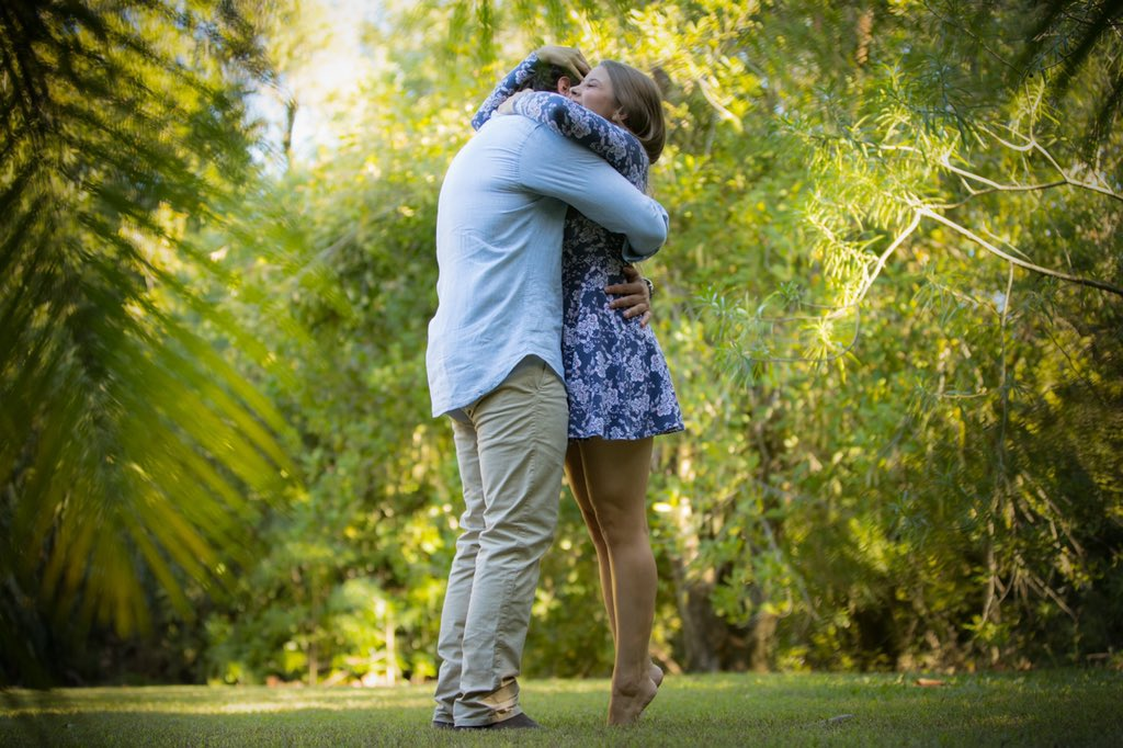 Bindi Irwin says a big yes and hugs Chandler Powell after he proposed at Australia Zoo on her 21st birthday.