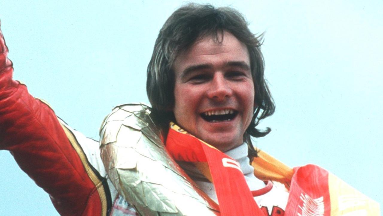 Barry Sheene celebrates after winning the German Formula One Racing Grand Prix in 1977. Credit: Allsport UK/ALLSPORT