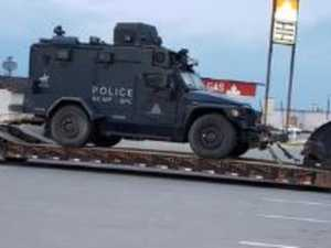 SWAT teams descend on tiny Canadian town in manhunt