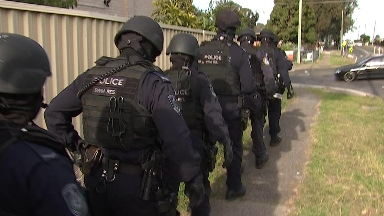 Police swarmed the properties as the investigation heated up. Picture: NSW Police
