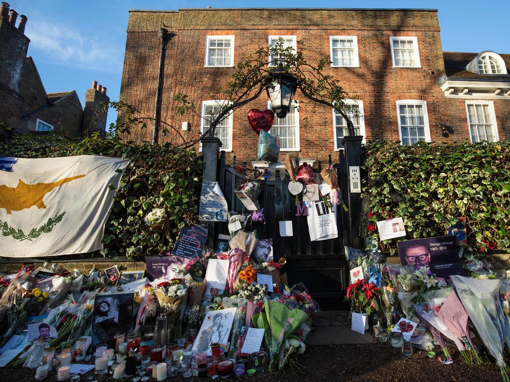 Tributes of flowers, photographs and candles are left outside the home of pop music icon George Michael in The Grove, Highgate in London, England, following his death. Picture: Getty