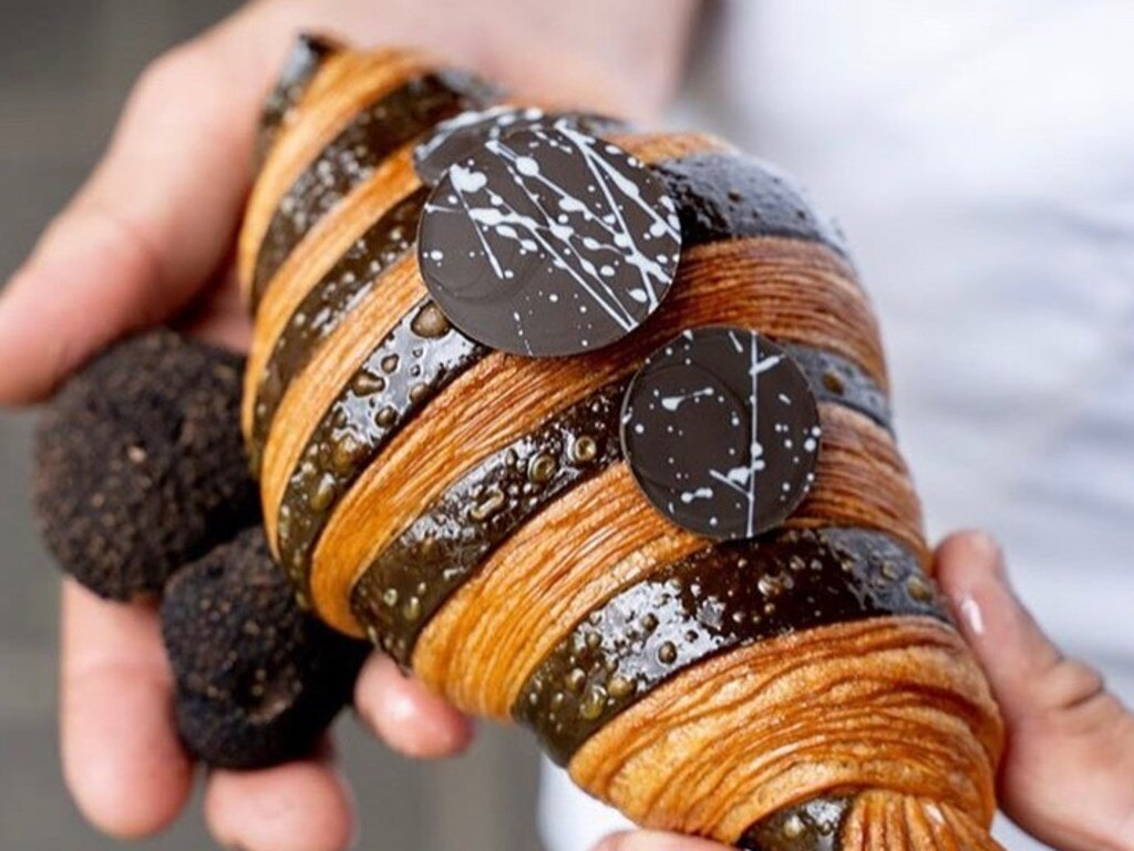 She purchased six of the $17 truffle croissants for $102.