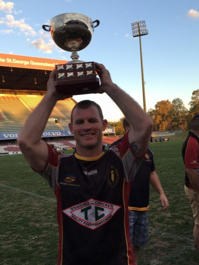 Luke Howard holding the premiership trophy for Caboolture Snakes Rugby Union Club in 2016.