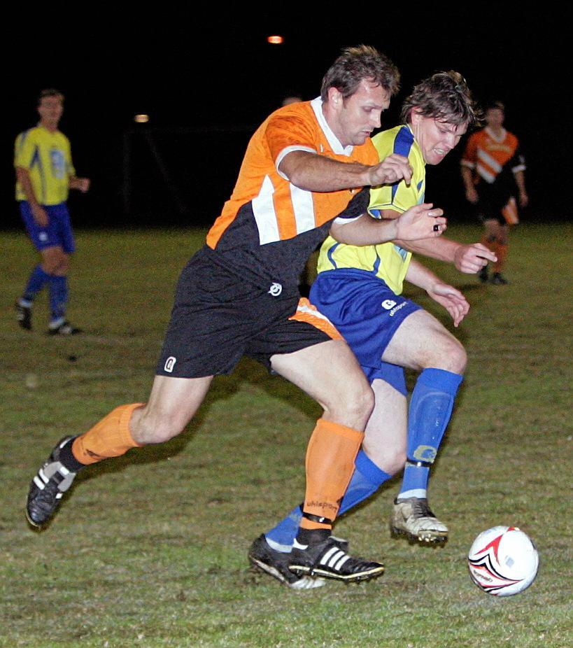 147953   22/07/05 Soccer Kawana v Buderim Buderims Shaun  Blackman and Kawana's Ryan Smith jostle for the ball in midfield.    Photo: Nicholas Falconer / Sunshine Coast Daily