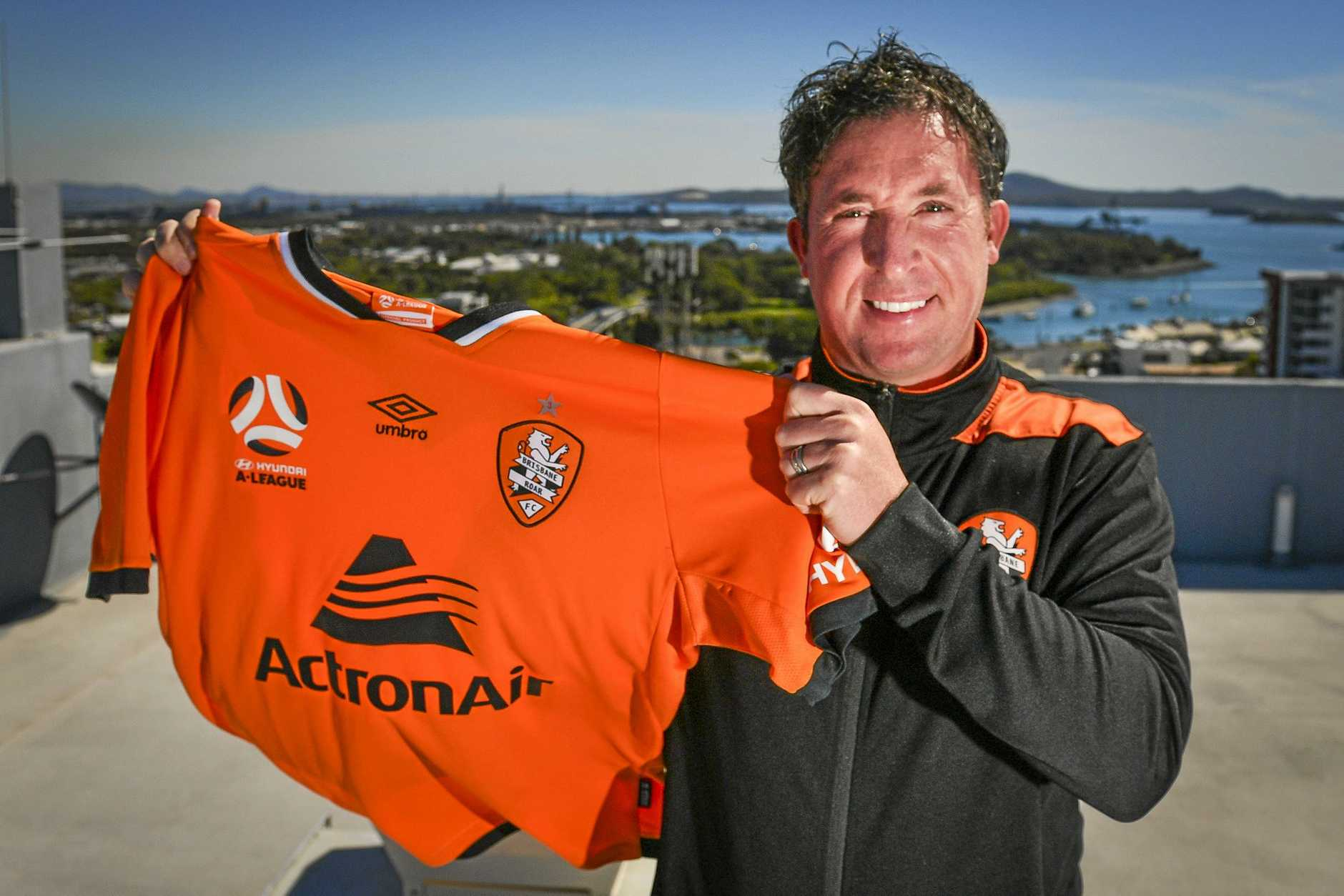 BLUE SKIES FOR ROAR: Brisbane head coach Robbie Fowler poses for photographs on the top of the Oaks Grand Hotel in Gladstone's CBD.