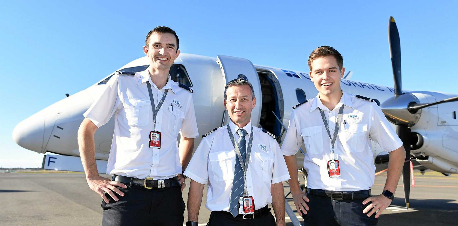 The first two students at the Sunshine Coast academy, Ian Nye and Adrew Lee, are graduating from the Airline Cadet Program at Flight Options Pilot Academy embark on their career with Corporate Air, one of the largest 24/7 aviation service providers in Eastern and Southern Australia. Pictured with Ian and Andrew is head of operations Tim Holland. The academy has just announced plans to expand into the Gympie Aerodrome.