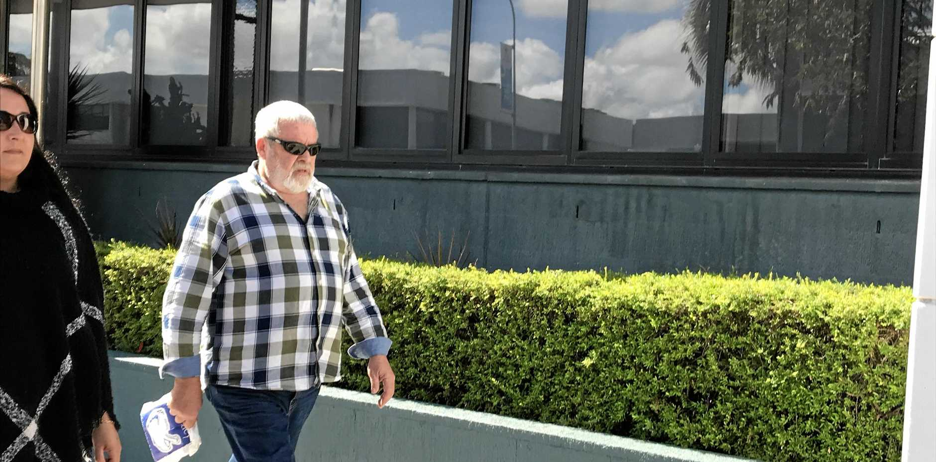 Robert Keith Hansen walks from the Sydney St police station after being handed a suspended sentence for dangerous conduct with a weapon and deprivation of liberty charges over a siege at Paget on March 11.
