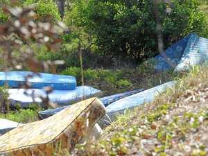 PHOTOS: More than a dozen mattresses lining embankment