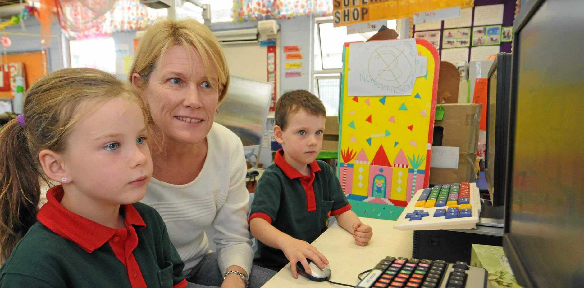 Eimeo State School students Jessica Campbell and Riley Eisemann with teacher Linda Vella, who has been nominated for Australian Early Childhood teacher of the Year. Photo Lee Constable / Daily Mercury