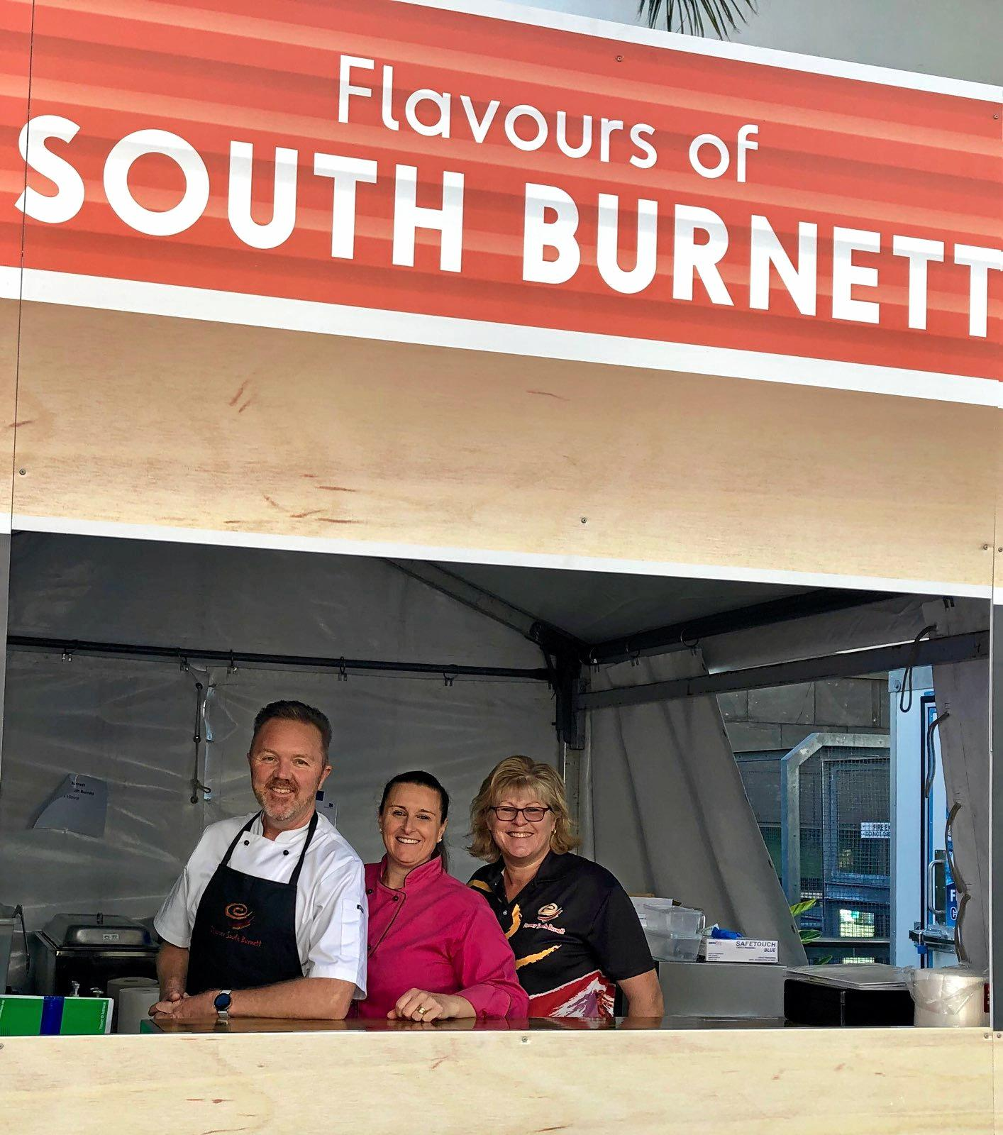 Jason Ford, Roberta Schablon, and Karen Ford cooking at the South Burnett stall at Regional Flavours.