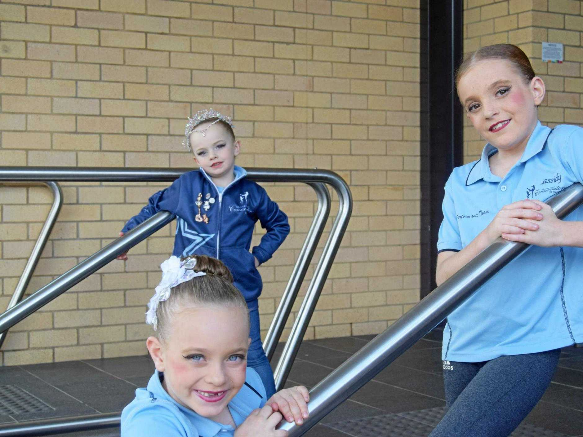 COMPETITORS: Ashlyn Brault, Frankie Stewart and Amaya Brault, from the Sunshine Coast Conservatory of Dance take a break during the competition.