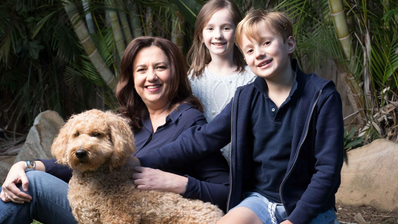Queensland Premier Annastacia Palaszczuk at home with her dog Winton and niece Evelyn, 6, and nephew Harry