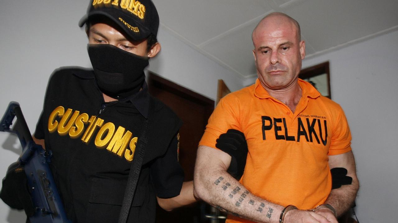 Michael Sacatides, 43, escorted by a customs official, October 2010.