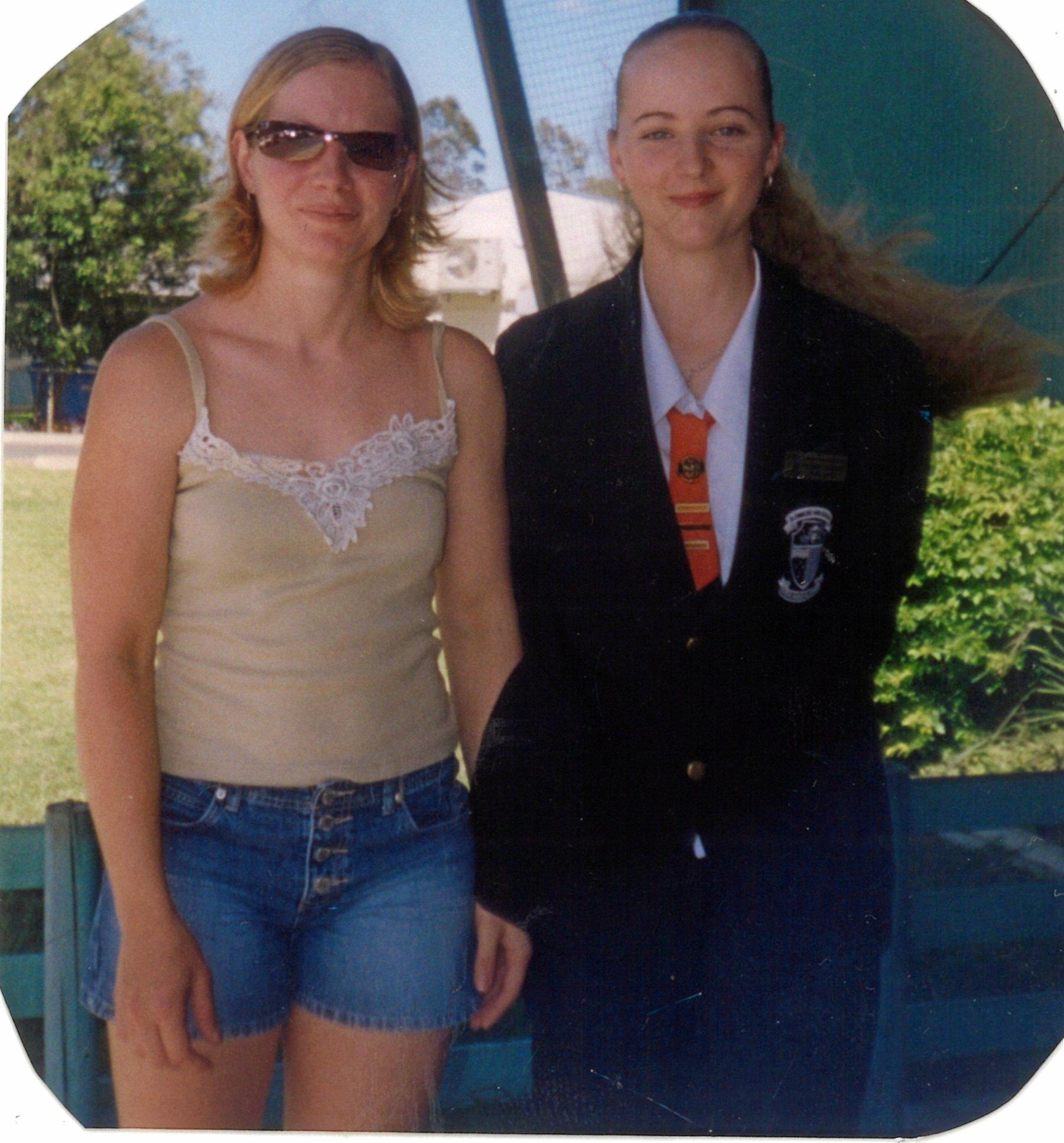 Belinda Sleeman (right) on her graduation day from Glenmore State High with sister Tanya.