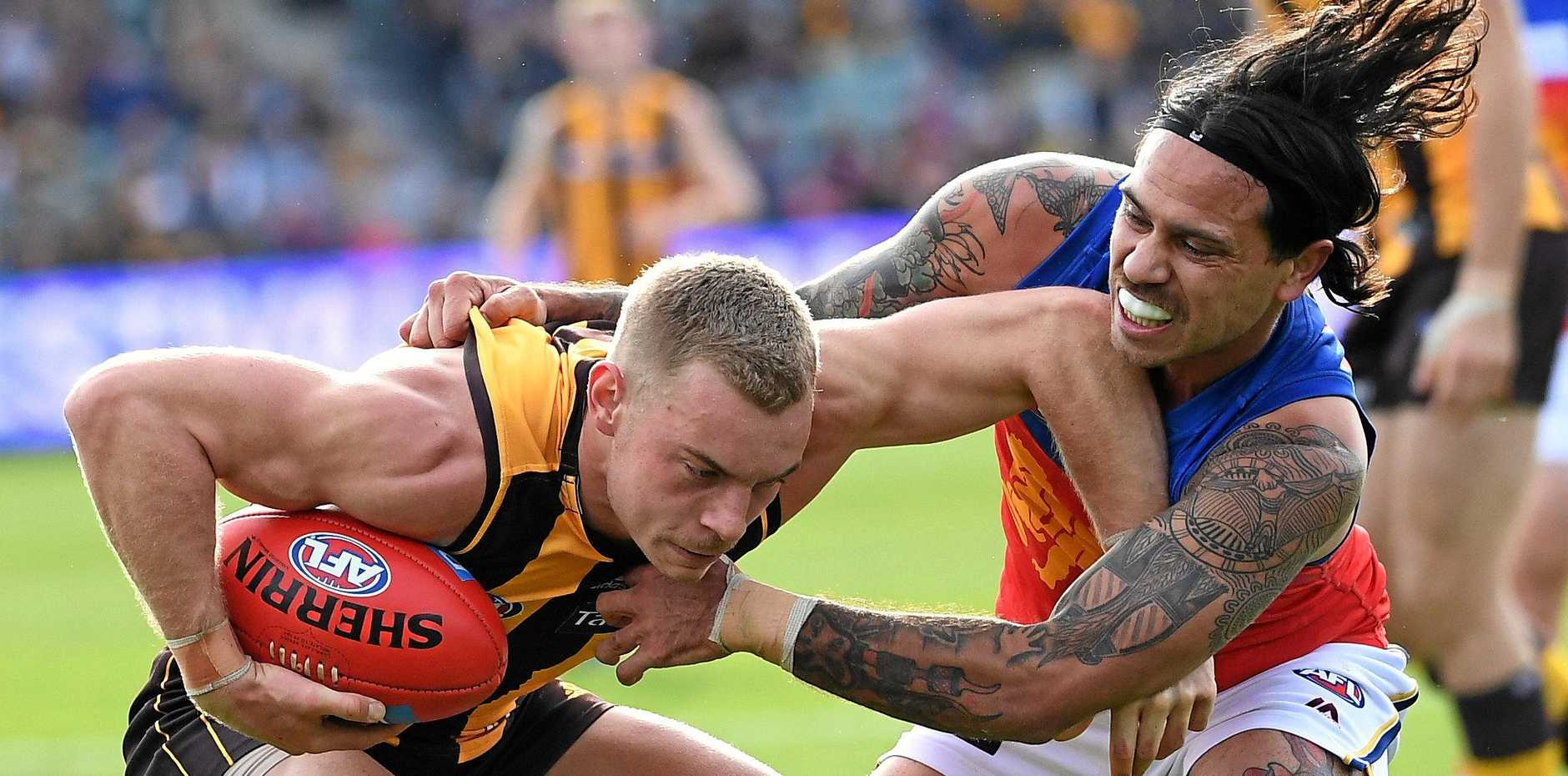 Hawthorn's James Worpel tries to escape the clutches of Brisbane's Allen Christensen on Saturday at the University of Tasmania Stadium. Picture: Julian Smith/AAP