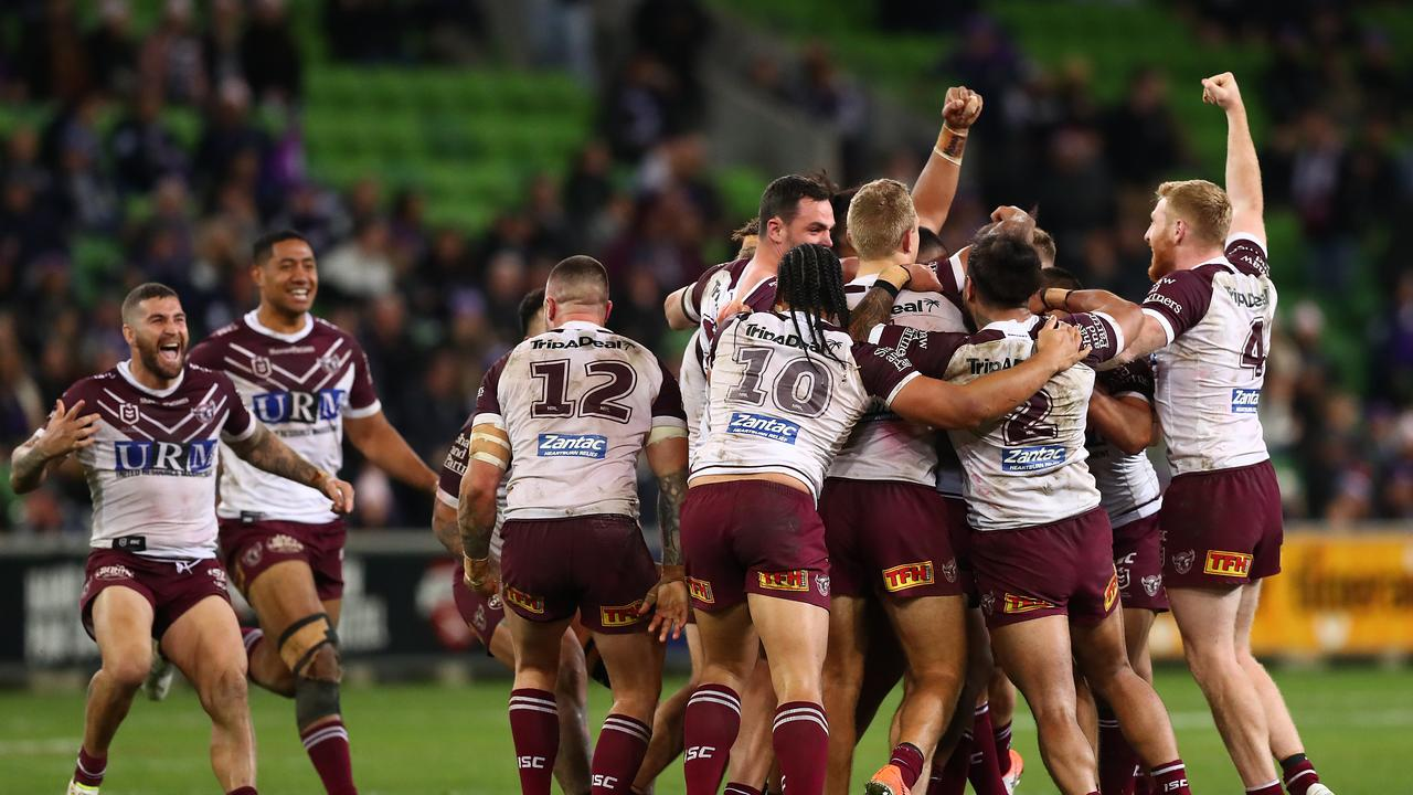 Manly celebrate their thrilling win. Picture: Kelly Defina