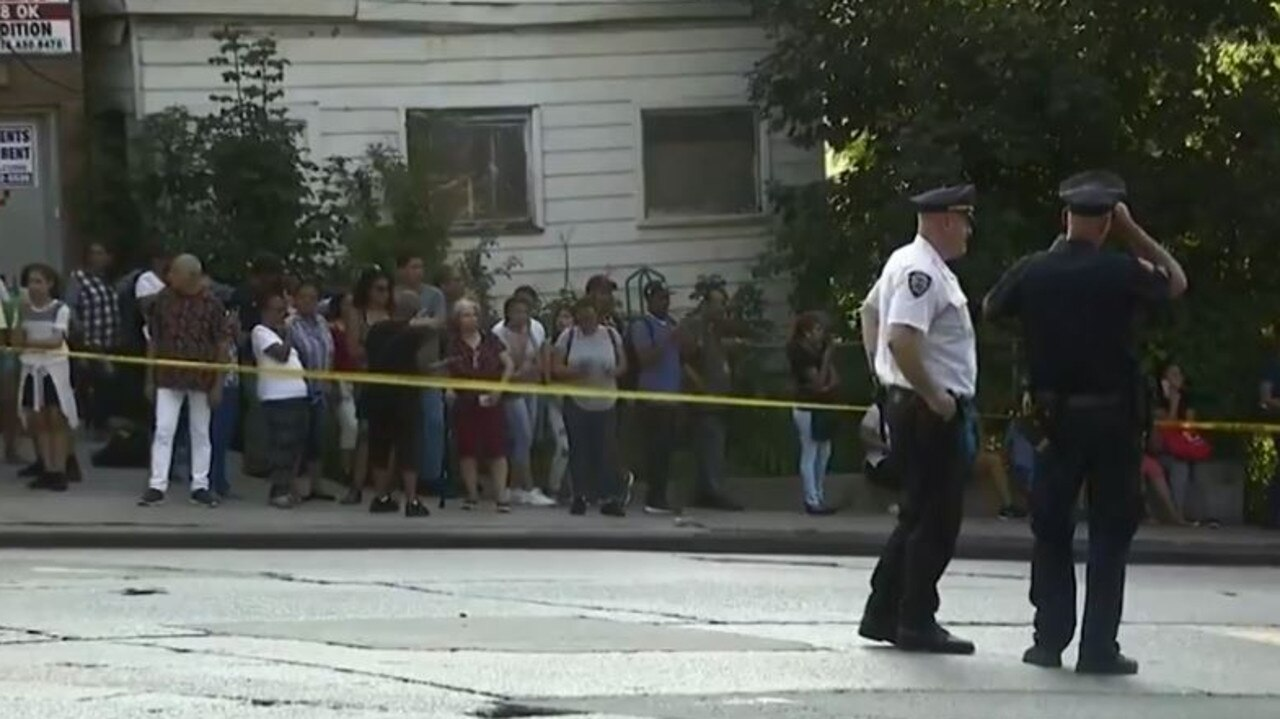 Crowds of stunned people gathered to watch police at the cordoned off scene. Picture: CBS New York