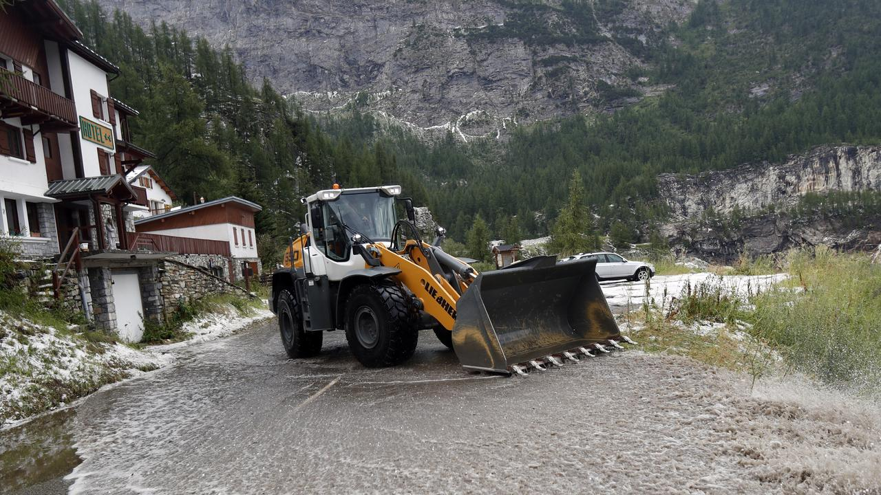 A snowplough was used to try to clear the roads but to no avail. Picture: Thibault Camus/AP